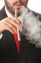 Business man smoking e cig electronic cigarette or he wears clasic black suit and red tie Stock Images