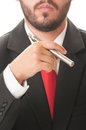Business man smoking electronic cigarette he wears clasic black suit and red tie Stock Image