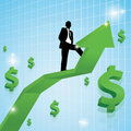 Business man standing on arrow with money sign Royalty Free Stock Image