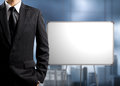 Business man standing and blank white board in office Royalty Free Stock Image