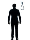 Business man standing in front of  hangman noose silhouette rear Stock Images
