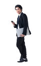 Business man standing with laptop and phone Royalty Free Stock Photo