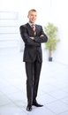 Business man standing in a light hall Royalty Free Stock Photo