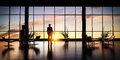 Business man standing in the office looking out of the window at sunset sky. Royalty Free Stock Photo