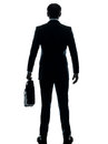 Business man standing rear view silhouette one caucasian businessman in studio isolated on white background Royalty Free Stock Photo