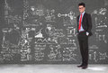 Business man stands in front of blackboard Royalty Free Stock Photos