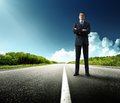 Business man stay on the road Royalty Free Stock Photos