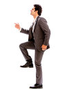 Business man stepping up isolated over white background Stock Photos