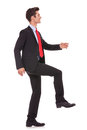 Business man stepping up and moving forward Royalty Free Stock Photo
