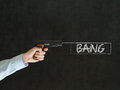 Business man student or teacher pointing a gun with bang text on blackboard background Royalty Free Stock Photo