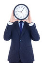 Business man in suit with clock covering face isolated on white background Royalty Free Stock Photos