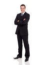 Business man suit friendly in a with arms folded isolated on white Royalty Free Stock Image
