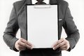 Business man in suit holding a blank clipboard Royalty Free Stock Photo
