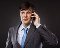 Business man talking on his cellphone Stock Photography