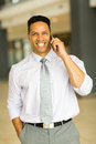 Business man talking on phone handsome mobile in office building Royalty Free Stock Photo
