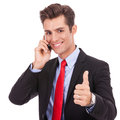 Business man talking on the phone and making ok Royalty Free Stock Photo
