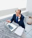 Business man talking a phone while using laptop Stock Images