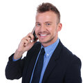 Business man talks on phone young the smiling to the camera white background Royalty Free Stock Photography
