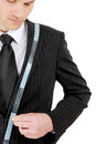 Business man with tape measure Royalty Free Stock Photo