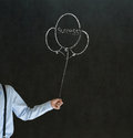 Business man teacher student arm hand holding chalk success balloons blackboard background Stock Photography