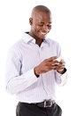 Business man texting on the phone his mobile isolated over a white background Royalty Free Stock Photos