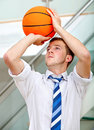 Business man throwing a basketball Stock Photos