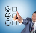 Business man touching emoticon of mood Stock Images