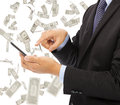 Business man touching smart phone with money rain background Royalty Free Stock Photo