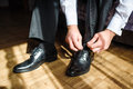 Business man tying shoe laces on the floor Royalty Free Stock Photo