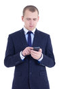 Business man typing sms on cell phone isolated on white background Royalty Free Stock Image