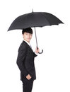 Business man with an umbrella concept for and insurance isolated against white background asian male model Royalty Free Stock Images