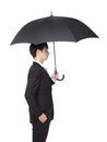 Business man with an umbrella concept for and insurance isolated against white background asian male model Royalty Free Stock Photos