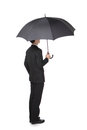 Business man with an umbrella concept for and insurance isolated against white background asian male model Stock Images