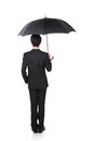 Business man with an umbrella concept for and insurance isolated against white background asian male model Stock Photos