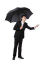 Business man with an umbrella concept for insurance and save money full length isolated against white background asian Stock Image