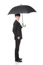 Business man with an umbrella concept for insurance and save money full length isolated against white background asian Stock Photos