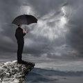 Business Man with umbrella look rainstorm cloud Royalty Free Stock Photo