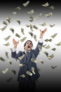 Business man under falling money banknotes screaming reaching fo for it dollar rain stressed grabbing Stock Images