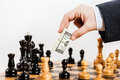 Business man unfair playing chess game Royalty Free Stock Photo