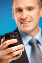 Business man using his mobile phone Stock Images