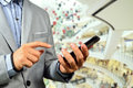 Business Man using Mobile Cell Phone in The Modern office buildi Royalty Free Stock Photo