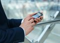Business man using mobile close up of a smart phone Royalty Free Stock Photo