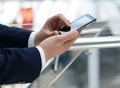 Business man using mobile close up of a smart phone Royalty Free Stock Photography