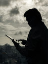 Business man using tablet silhouette of asian in the office Stock Image