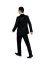 Business man walk away isolated Stock Image