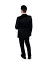 Business man walk back isolated Stock Photography