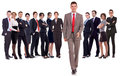 Business man walking forward leading team Stock Photo