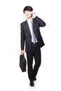 Business man Walking and speaking mobile phone Stock Photos