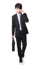 Business man Walking while talking phone Royalty Free Stock Photo