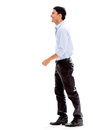 Business man walking to side isolated over white background Stock Images
